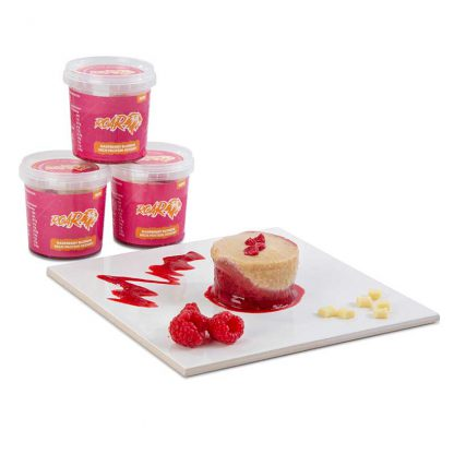 White chocolate and raspberry blondies desserts for athletes with three pots stacked in the background and one emptied onto a white board and decorated with raspberries