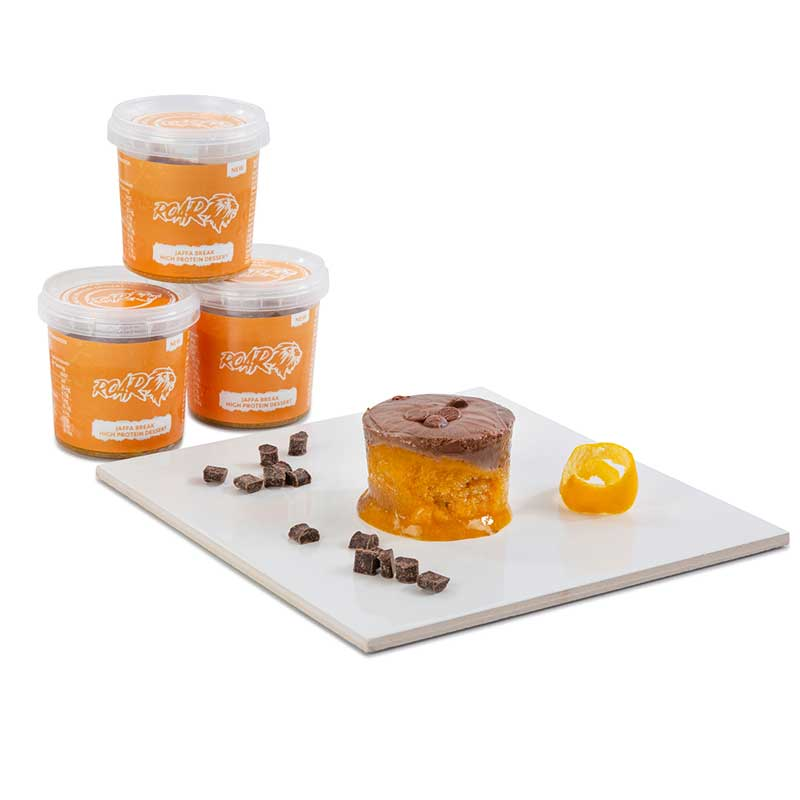 Jaffa break ROAR pots displayed with three stacked up and one emptied onto a board, one of the ultimate desserts for athletes from ROAR