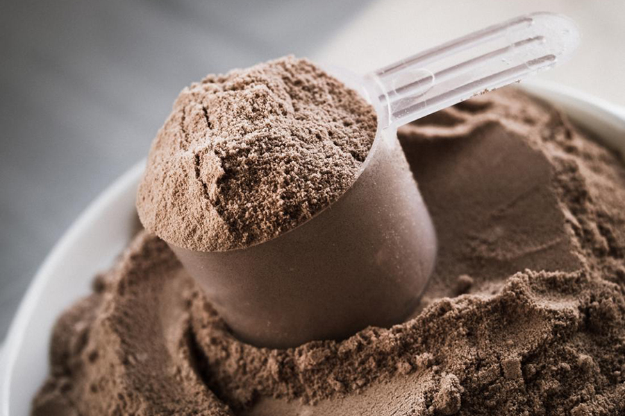 Chocolate flavoured whey protein on the go in powder form to be used as a shake